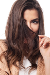 Does coconut oil dry our hair or darken hair color?